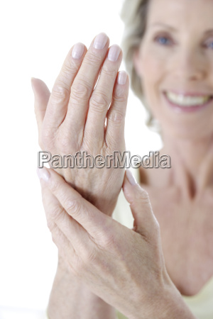 senior woman smiling and looking at
