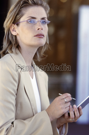 woman using a pda looking up