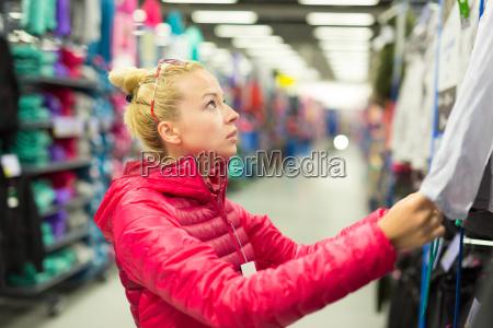 woman shopping sportswear in sports store