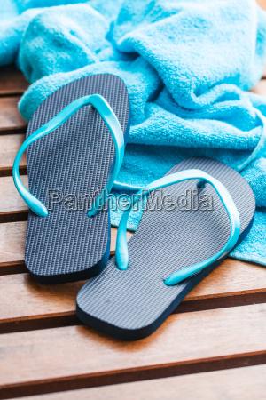 blue flip flops with towel