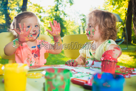 two year old girls painting with
