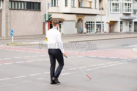 blind man crossing road