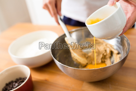 woman mixing the paste with adding