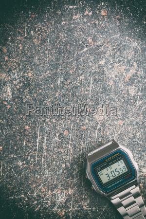 digital watch on crackle background