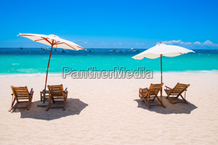 white sand beach with umbrellas and