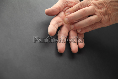 elderly man with hand pain