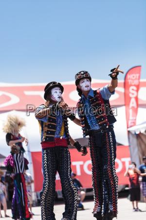dragon knights steampunk stilt walkers perform