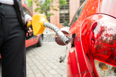 close up of businesswomans hand refueling