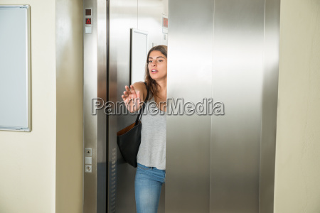 young woman in elevator