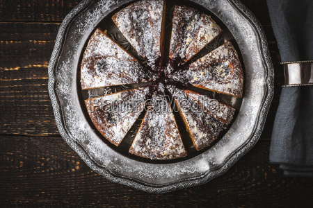 sliced cake with icing sugar and