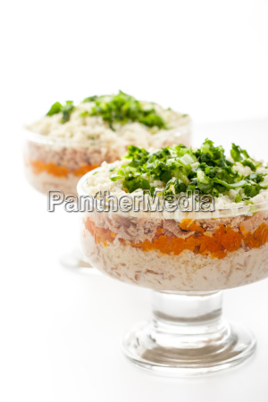 layered salad with eggs and fish