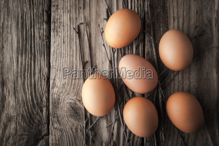 chicken eggs on a wooden table