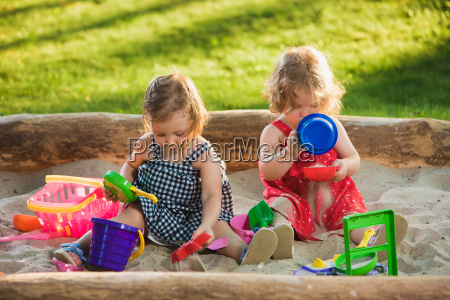 the two little baby girls playing