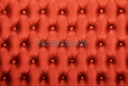 red capitone tufted fabric upholstery texture