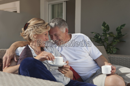 mature couple drinking coffee on terrace