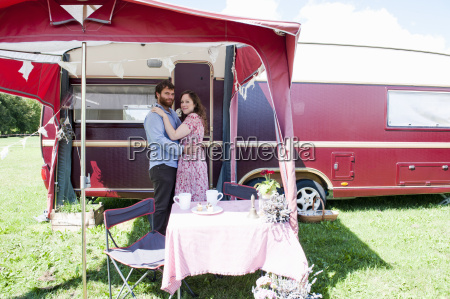 couple hugging outside trailer