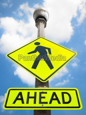 crossing road sign against blue sky
