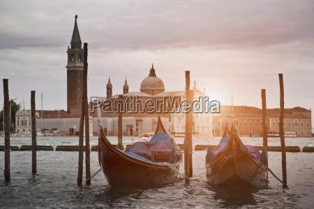 gondolas docked on urban canal