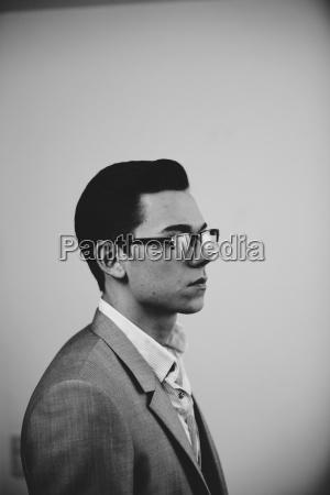 businessman wearing reflective glasses
