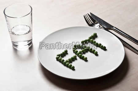 peas arranged to spell fat on