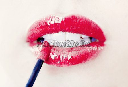 close up of womans lips with