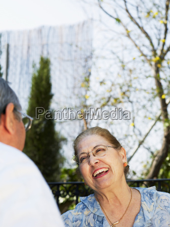 senior couple outdoors woman laughing