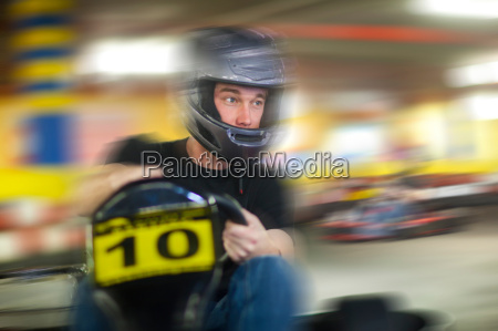 young man racing in go cart