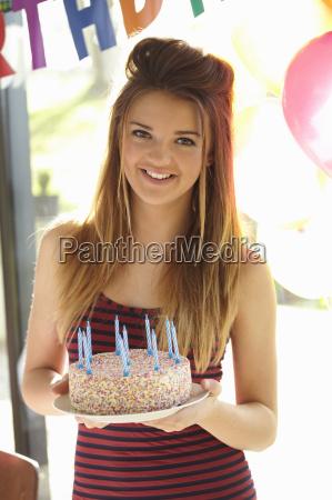 portrait of teenage girl holding