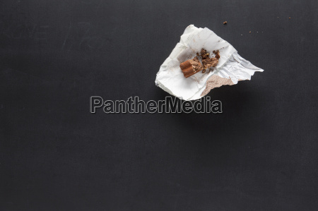 confectionery in paper wrapper on blackboard