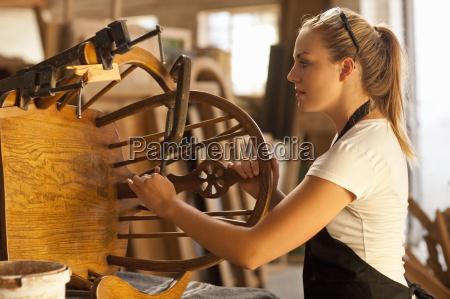 carpenter measuring wooden chair