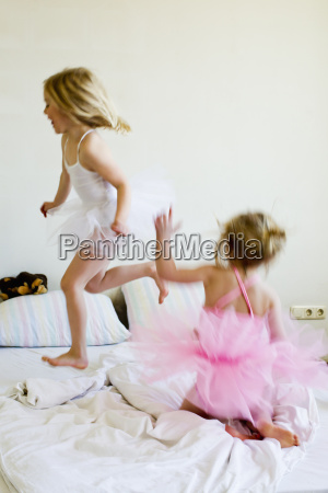 sisters dressed as ballet dancers running