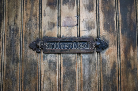 detail of rustic letterbox and wooden