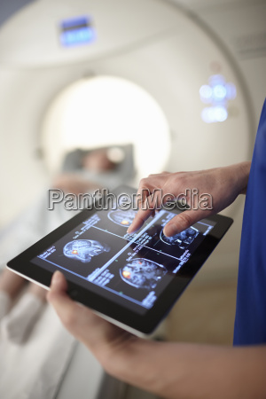 radiographer looking at brain scan image