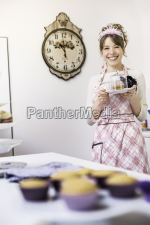 woman holding up plate of homemade