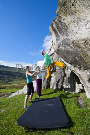 male climber bouldering on rac boulders