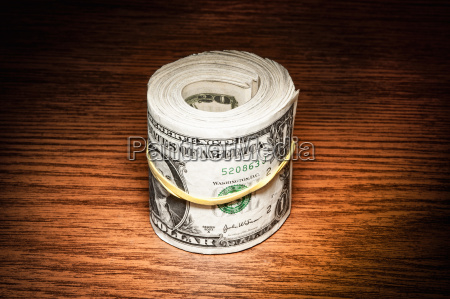 roll of american dollar notes wrapped