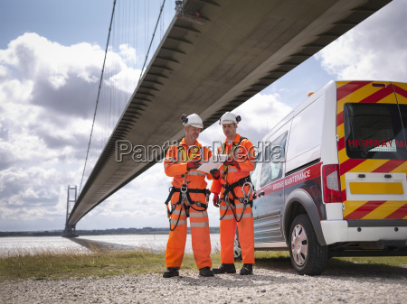 bridge workers and support truck under