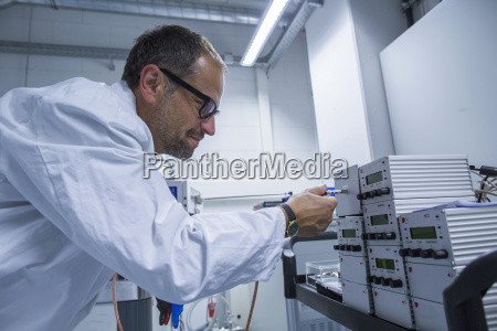 lab assistant working on equipment