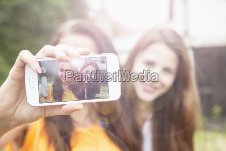 young women taking selfie on smartphone