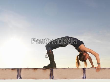 woman bending backwards into arch