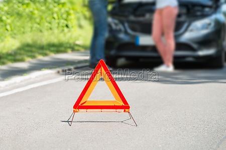 close up of a triangular warning