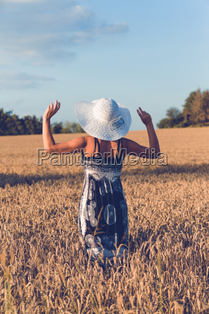 middle aged beauty woman in wheat