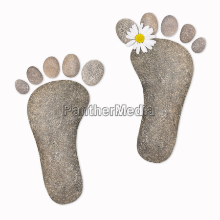 feet with chamomile stones