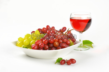 fresh grapes and glass of wine