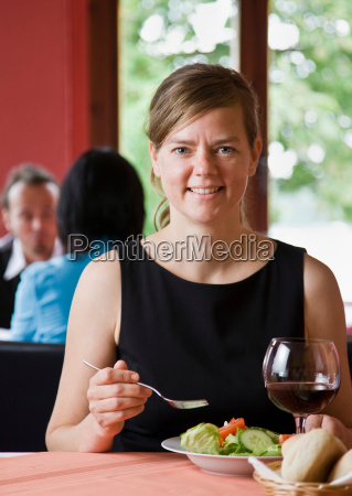 portrait of a woman eating a