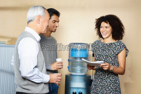 casual meeting by office water cooler