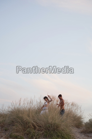 couple playing in the reed at