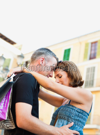 couple holding each other smiling