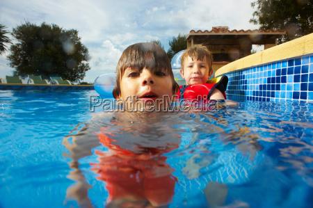 two young boys in swimmingpool