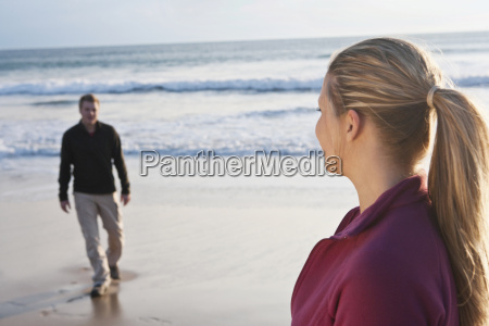 young couple meeting each other at